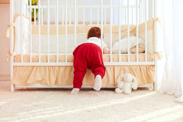 baby sneaking crib